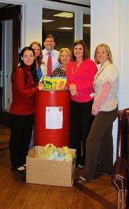 The attorneys and staff at Riddle & Brantley collecting donations for the Salvation Army Food Drive
